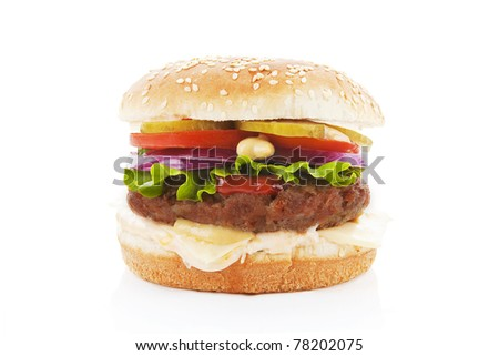 Big hamburger with fresh vegetables isolated on white.