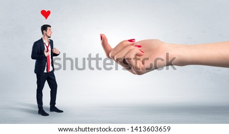 Big hand baiting man in love with kissed face