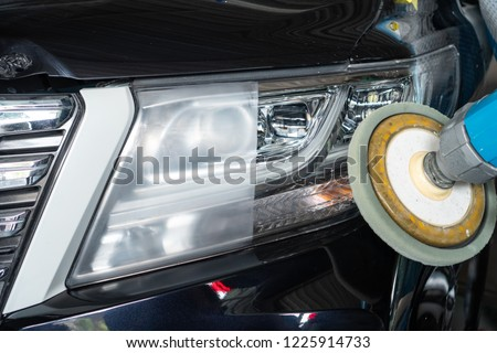 Big headlight cleaning on the car with power buffer machine at service station ,Before and after cleaning #1225914733