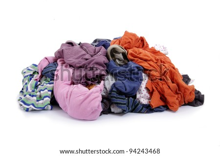 Big heap of colorful clothes on white background