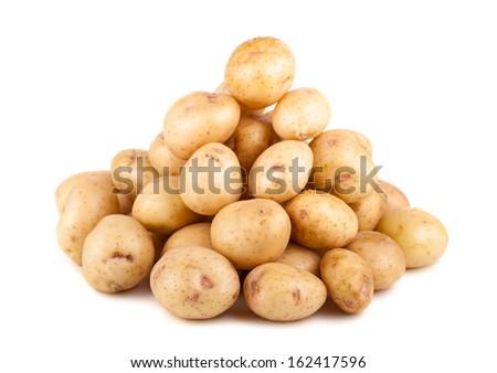 Big heap of uncooked ripe potato isolated on white background