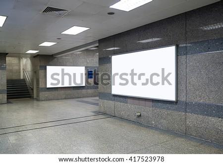 big horizontal billboard on metro station, advertisement on billboard,blank billboard