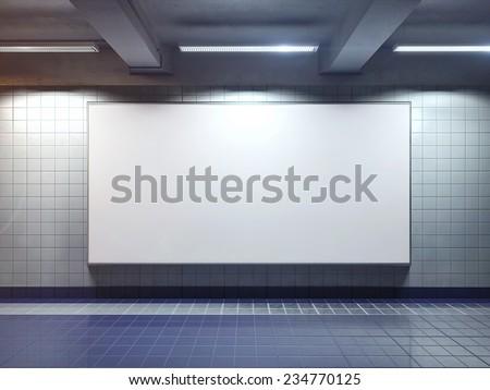 big horizontal poster on metro station