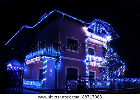 big house illuminated for Christmas
