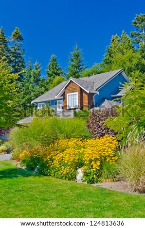 Big house with great front yard landscape design in the suburbs of Vancouver, Canada.