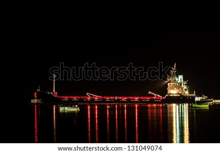 Big Industrial cargo ship on the water