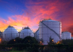 big Industrial oil tanks in a refinery at twilight