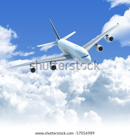 Big Jet airplane flying over a clear cloudscape seen from the top front, clipping path on the plane for easy isolation from the background