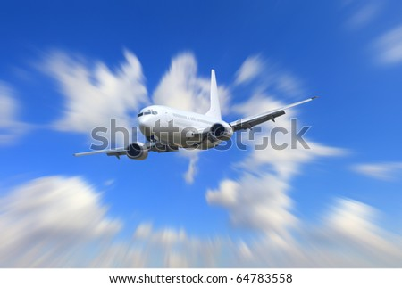 Big jet plane flying on blur motion sky background - stock photo