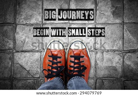 Big journeys begin with small steps, Inspiration quote, shoes on pavement