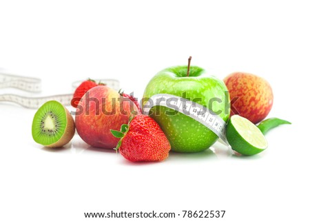 big juicy red ripe strawberries,apple,lime,peach,kiwi  and measure tape isolated on white