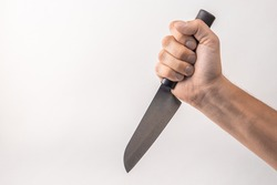 Big kitchen knife in man hand on white background. isolated on white background. Man threaten somebody with knife. Killer concept. Cooking equipment.
