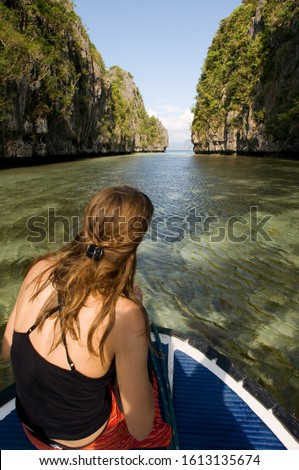 Big Lagoon Palawan Philippines, Southeast Asia, Asia. 10 January 2020: Tourist girl in a boat in Big Lagoon El Nido, Miniloc Island, Big Lagoon Palawan Philippines, Southeast Asia, Asia