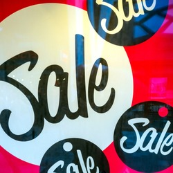 big letters indicate sale in shop windows of store