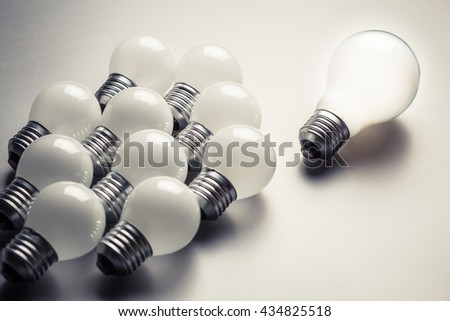 Big light bulb as leader with many small bulbs as follower #434825518