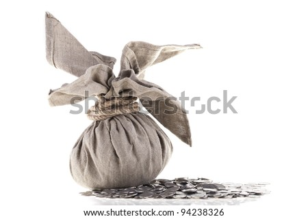 Big linen bag full of money tied by rope lying on one polish zloty coins. Money and savings concept on white background. - stock photo