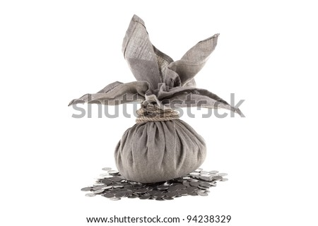 Big linen bag full of money tied by rope lying on one polish zloty coins. Money and savings concept on white background.
