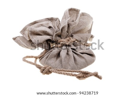 Big linen bag full of money tied by rope. Money and savings concept on white background.