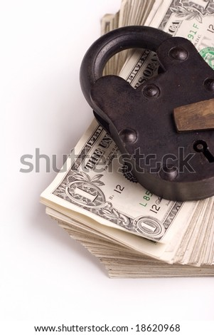 big lock on a stack of money