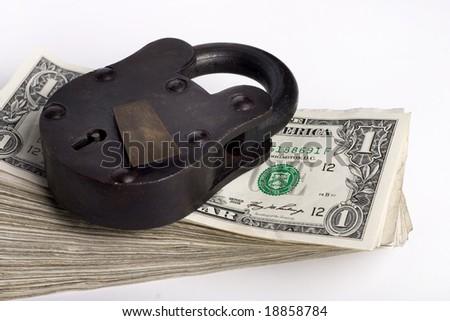 big lock on stack of money