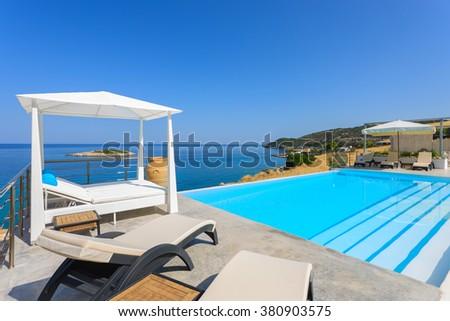 big luxury gazebo in a pool of a luxury resort in Greece #380903575