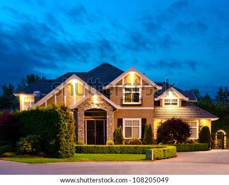 Big luxury house at dusk, night in suburbs of Vancouver, Canada