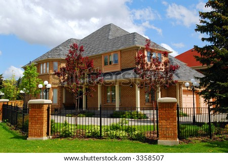 Big luxury residential house with iron fence