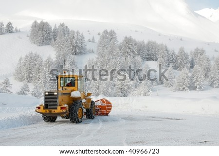 Big machine cleaning the snow from the road