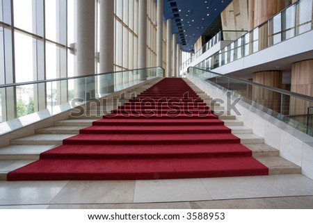 big marble stairs with red velvet