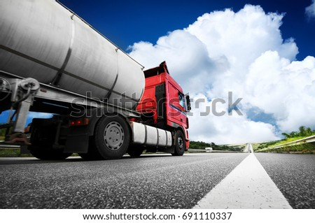 Big metal fuel tanker truck shipping fuel against blue sky