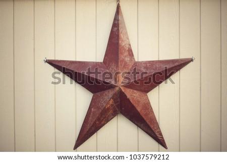 Big metal star on farm building