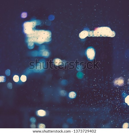 Big metropolitan city lights at night, blurry background - night life, abstract background and modern dark tones concept #1373729402