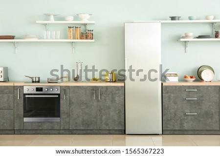 Big modern fridge in interior of kitchen