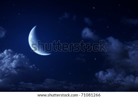 Big moon and stars in a cloudy night blue sky. fantastic beautiful landscape