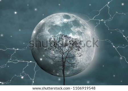 Stock Photo Big moon, Tree in the middle, Lightning around, With background is sky and clouds.