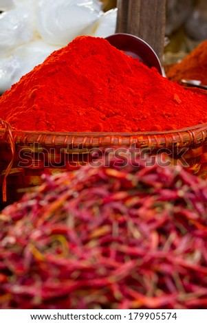 Big mounds of hot, spicy red chilli powder for sale at a market in Myanmar (Burma)