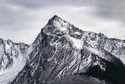 Big mountain peak with snow covered and overcast sky in Canada