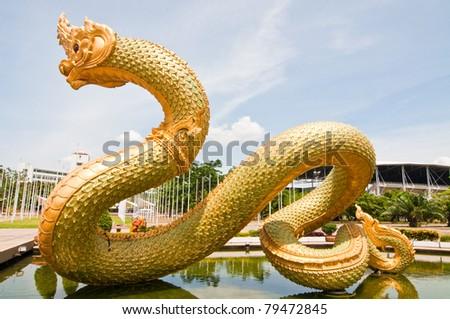 Big Naga statue on the pond, Thailand. - stock photo