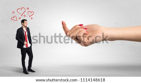 Big naked hand baiting man in love with kissed face #1114148618