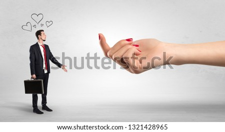 Big naked hand baiting man in love with kissed face #1321428965