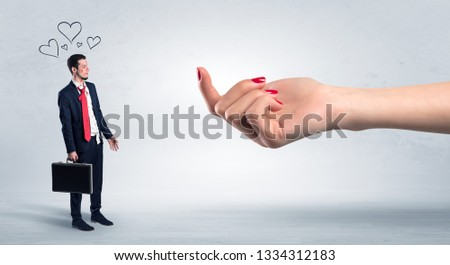 Big naked hand baiting man in love with kissed face #1334312183
