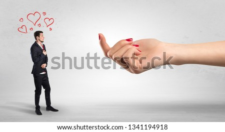 Big naked hand baiting man in love with kissed face #1341194918