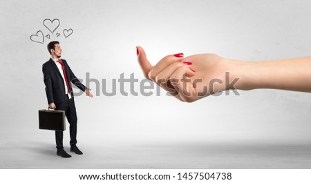 Big naked hand baiting man in love with kissed face