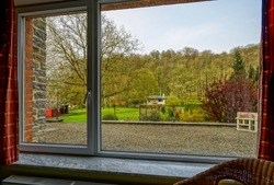 Big new pvc plastic window, view from the inside to the garden, interior design