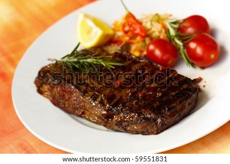 big new york strip steak,grilled,with salad - stock photo