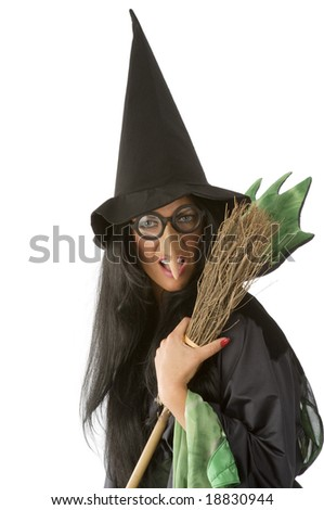 big nose and glasses as an old ugly witch keeping a broom - stock photo