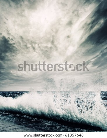 Big ocean wave breaking the shore