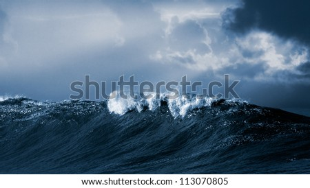 Big ocean wave crashes on the Portuguese coast - Toned black and white