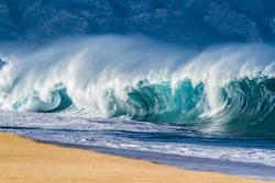 Big Ocean wave hitting the beach in Hawaii