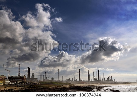 Big oil refinery near the sea in a cloudy morning